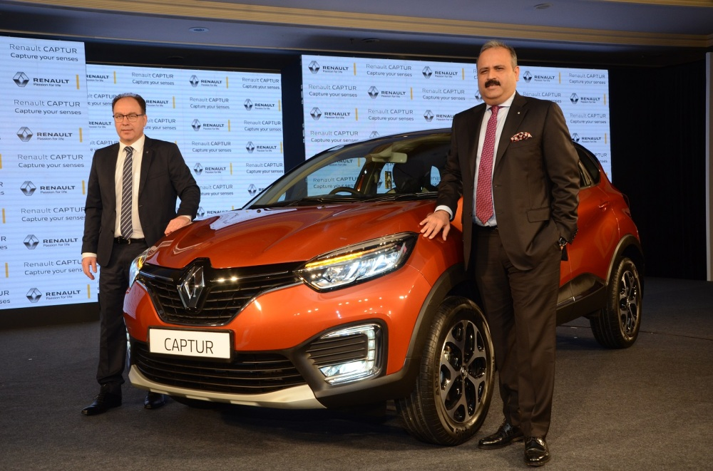 From R-L-Mr. Sumit Sawhney, Country CEO and MD, Renault India Operations and Rafael Treuguer, VP,Marketing and Sales, Renault India at the launch of CAPTUR in New Delhi (1).jpg